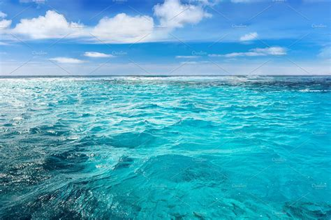 Caribbean sea bottom with blue water wave background